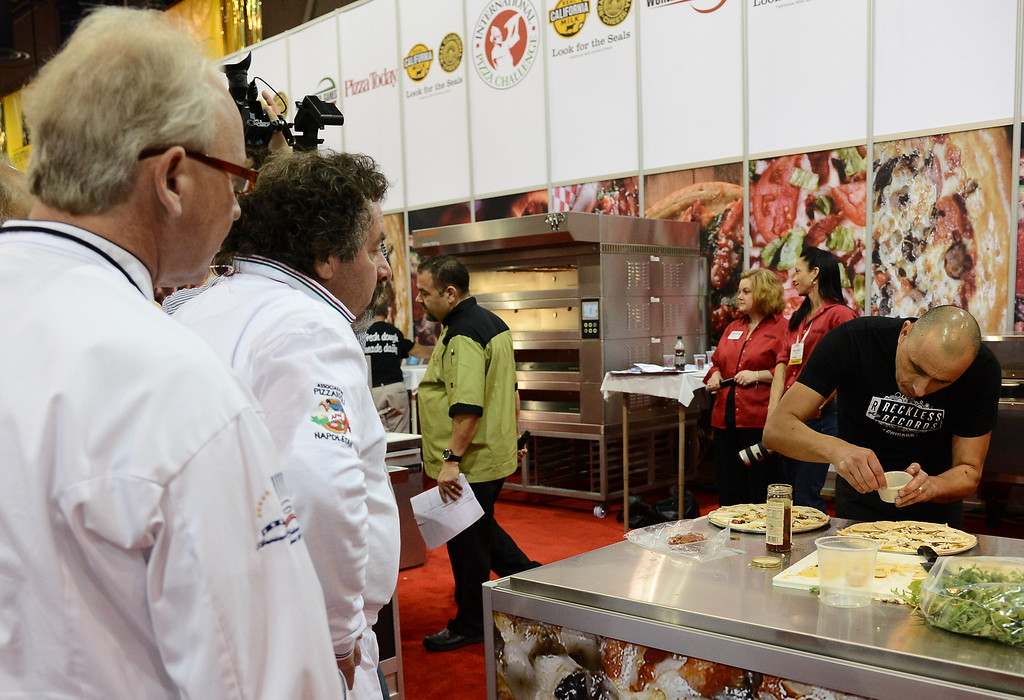 . March 19,2013. Las Vegas NV. USA. Pizza chef\'s   are watch by the judges in the international pizza challenge during the world pizza games at the 2013 International Pizza Expo. Photo by Gene Blevins/LA DailyNews