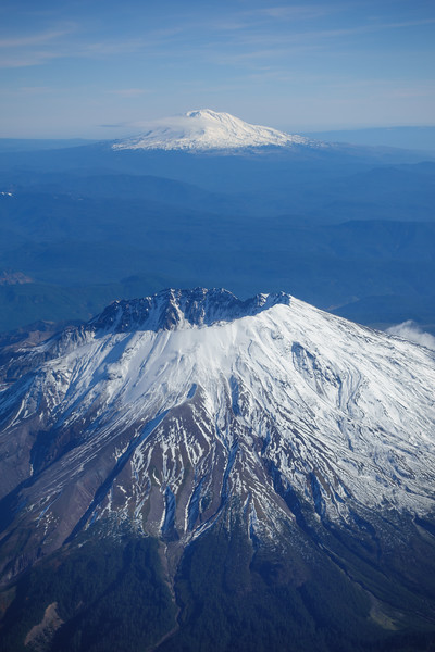 Snowcapped Mount Saint Helens is seen in front of Mount Rainier in an aerial image taken from a commercial airliner flying over Washington State