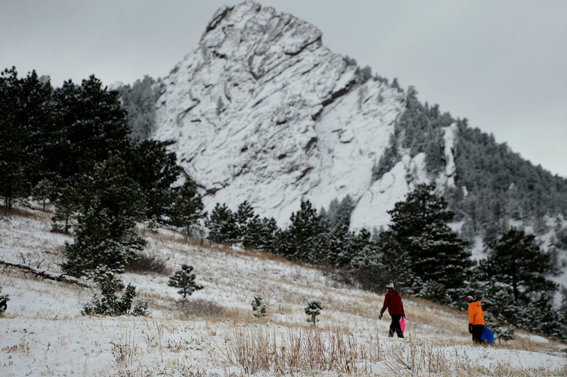 . Renee Farrar a 28 year old CU student and her friend Rachel Haungs from the University of Texas trudge up the  hill with their sleds in front of the slabs at Chautauqua Park in Boulder Colorado, Wednesday, December 19,  2012.    Joe Amon, The Denver Post
