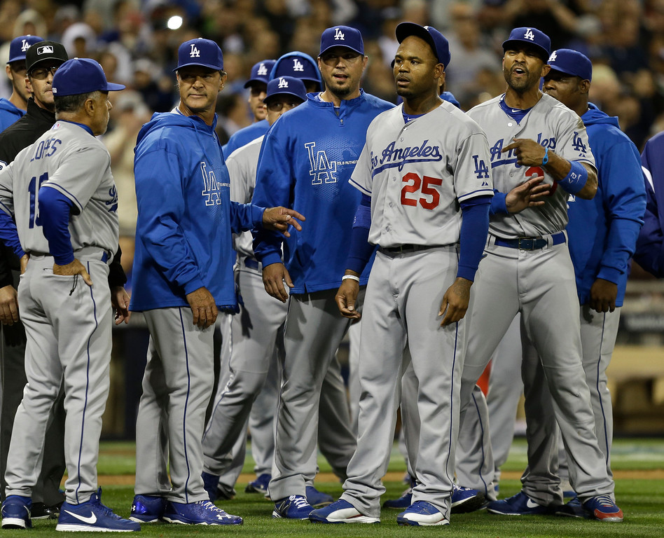 . Los Angeles Dodgers\' Carl Crawford, (#25), Matt Kemp, right, Josh Beckett, third from left, and manager Don Mattingly, fourth from left, stand in front of the San Diego Padres dugout in a confrontation following a brawl during the eighth inning of baseball game in San Diego, Thursday, April 11, 2013. The braw started when San Diego Padres\' Carlos Quentin was hit by a pitch from Dodgers pitcher Zack Greinke.  (AP Photo/Lenny Ignelzi)