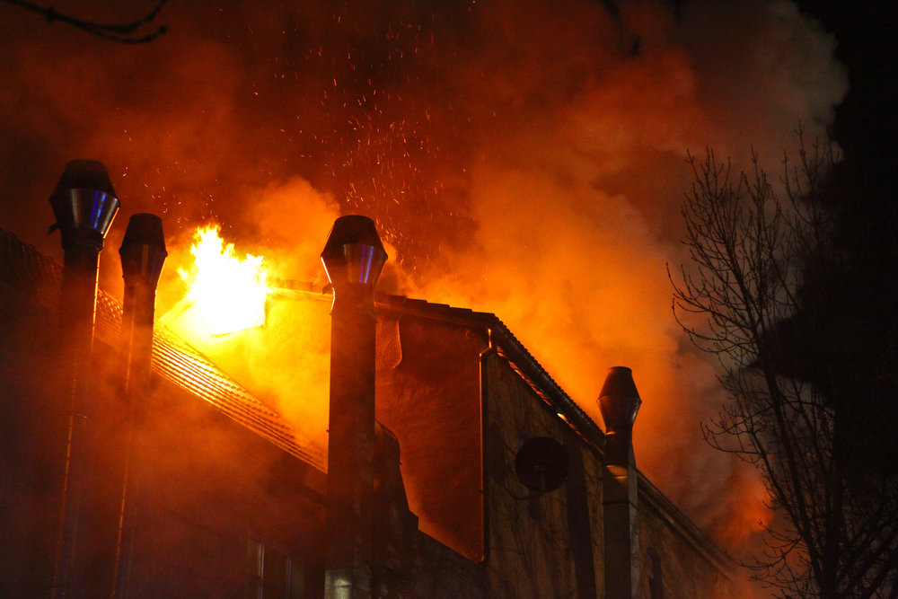 . A blazing fire leaks from the roof of a building in Backnang, Germany, on March 10, 2013. At least seven people died in the blaze which broke out in the former factory building, according to a police statement.  FRANZISKA KRAUFMANN/AFP/Getty Images