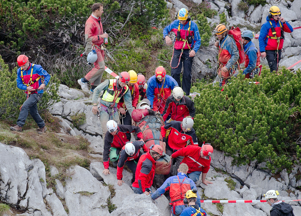 . Mountain rescuers carry cave researcher Johann Westhauser , center, out of the Riesending cave near Marktschellenberg, southern Germany, Thursday June 19, 2014.  (AP Photo/dpa,Nicolas Armer)