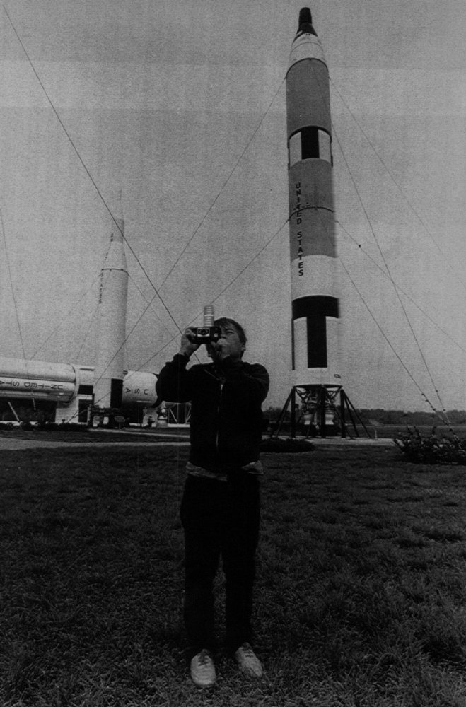 """Description of . Fifth-grader Austin Montgomery photographs an exhibit at the \""""Rocket Garden\"""" at the Kennedy Space Center during a tour  Saturday. Montomery was on a class field trip from Colordo to see the Challenger launch in January 1986.  Karl Gehring, The Denver Post"""