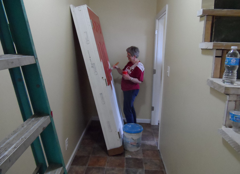 A Youth Build representative volunteers inside the house that will be dedicated for Connie Cash on April 19, 2013.