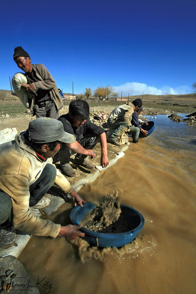 GOLD RUSH - Ninjas pan for the precious metal in a river in the Sarangol Valley, 200 KMs Northwest of the Capital city Ulan Bator, Mongolia.
