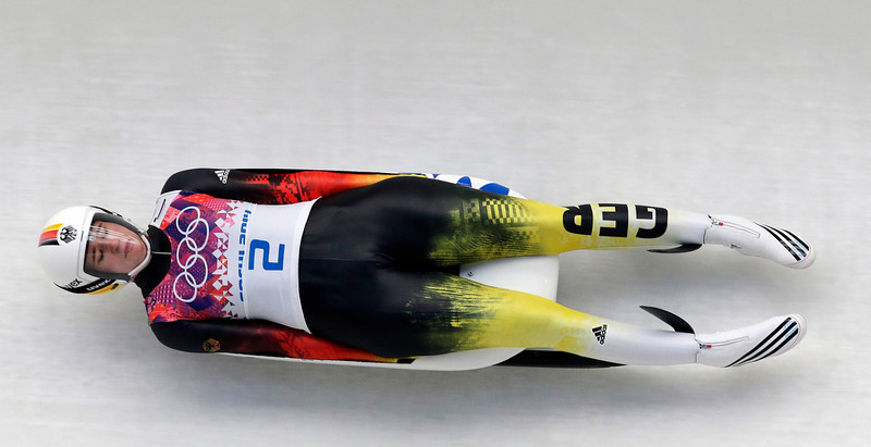 . Natalie Geisenberger of Germany speeds down the track in her third run during the women\'s singles luge competition at the 2014 Winter Olympics, Tuesday, Feb. 11, 2014, in Krasnaya Polyana, Russia. (AP Photo/Michael Sohn)