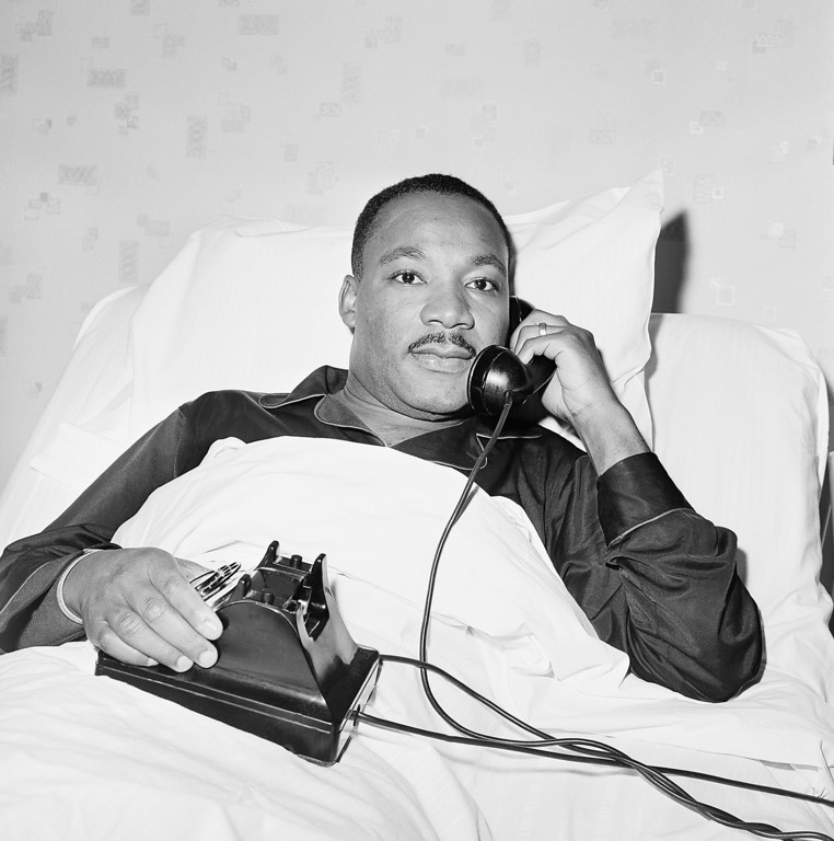. Integration leader Dr. Martin Luther King Jr. receives word by phone that he has been awarded the Nobel Peace Prize as he lies in hospital bed in Atrlanta, Ga., October 14, 1964, where he went for a checkup. (AP Photo)