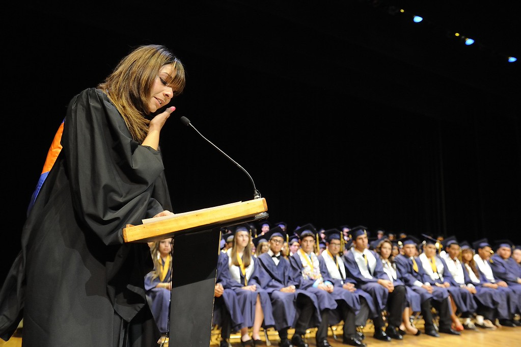 . TORRANCE, CALIF. USA -- Teacher Brenda Venegas wipes a tear from her eye as she talks about her class during commencement ceremonies for Lennox Math, Science & Technology Academy at El Camino College in Torrance, Calif., on June 8, 2013.   Photo by Jeff Gritchen / Los Angeles Newspaper Group