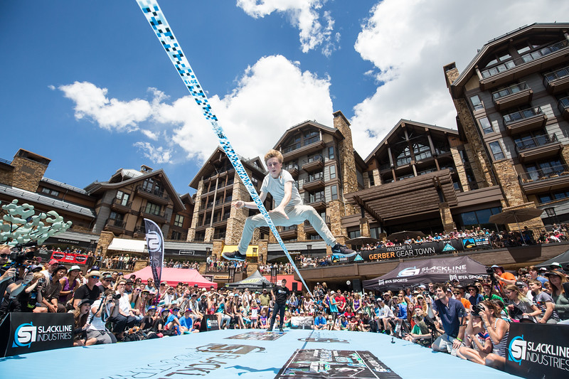 Redbull athlete Alex Mason wows the crowd with his areal moves during the Slackline Invitational Men's finals at Solaris Plaza on Sunday. Professional slackliners from all around the world competed head-to-head for $10,000 in cash prizes.