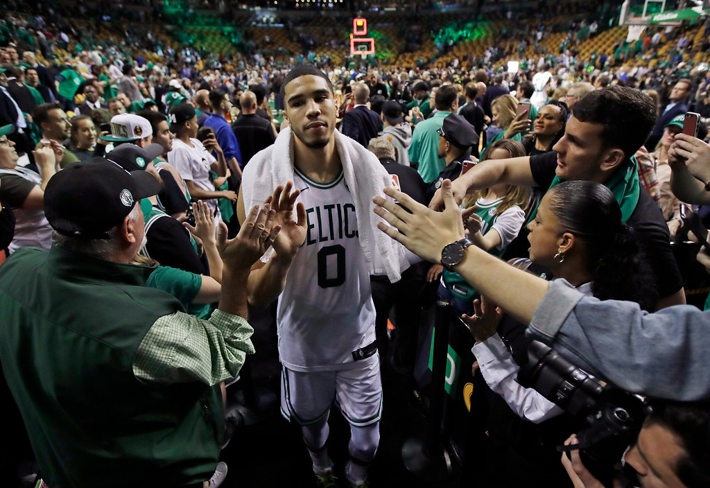 . Fans reach out to Boston Celtics forward Jayson Tatum (0) after Game 5 of the team\'s NBA basketball Eastern Conference finals against the Cleveland Cavaliers, Wednesday, May 23, 2018, in Boston. The Celtics won 96-83. (AP Photo/Charles Krupa)
