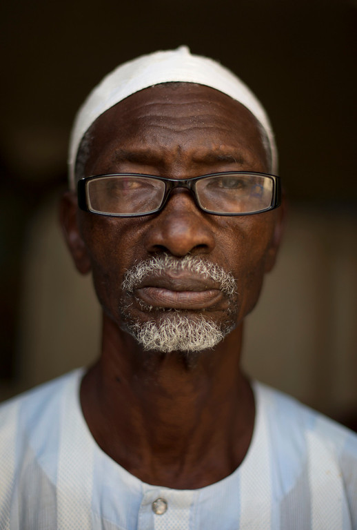 """. Amadou Mbaye, 74, poses for a portrait in Dakar, Senegal on Sunday, Sept. 1, 2013. When asked what his greatest fear was as he grew older, Mbaye replied that his only concern was for the future of the younger generation. \""""Since God allowed me to live to 74, I can only thank him. I am really satisfied. I am concerned for the young children, and I am really worried for their future. Life is too expensive, there is too much unemployment, their health is precarious.\"""" In response to the question of what is the greatest problem facing the elderly in Senegal, Mbaye responded that poor economic conditions make the financial situation of the elderly more unpredictable than in the past, when they could count on their children to support them. \""""Senegal is a poor country. There is no employment for the young to allow them to care for the elderly, and we no longer have the strength to work to support the household.\"""" (AP Photo/Rebecca Blackwell)"""