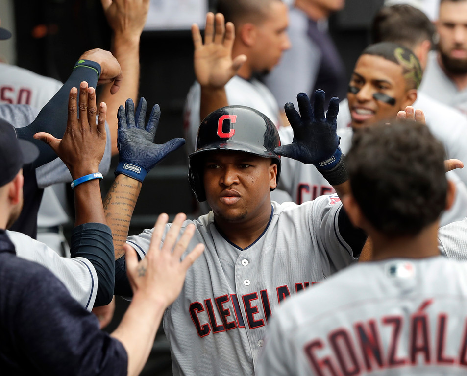 . Cleveland Indians\' Jose Ramirez celebrates in the dugout after hitting a two-run home run off Chicago White Sox\'s Chris Volstad during the seventh inning of a baseball game Thursday, June 14, 2018, in Chicago. Francisco Lindor also scored. (AP Photo/Charles Rex Arbogast)