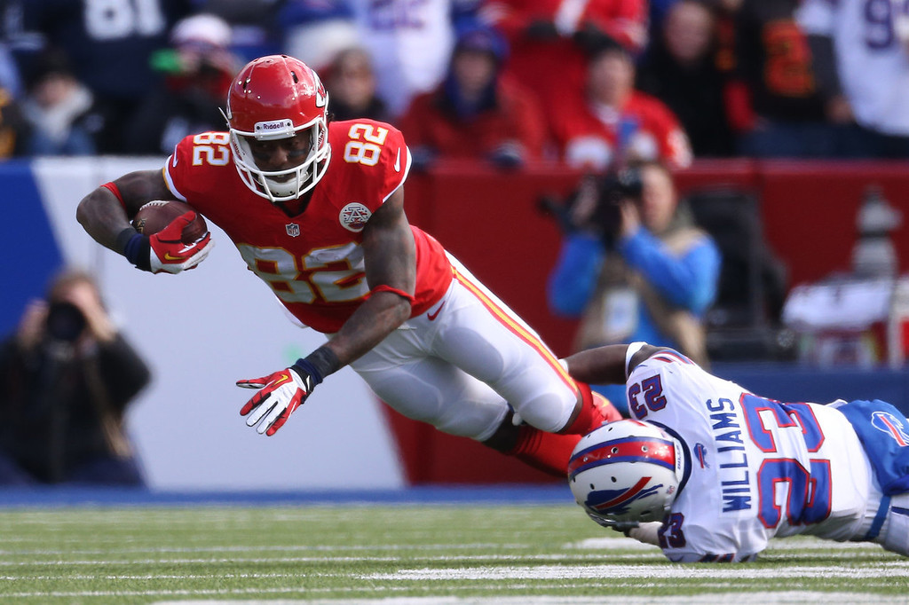 . Dwayne Bowe #82 of the Kansas City Chiefs is tackled during NFL game action by Aaron Williams #23 of the Buffalo Bills at Ralph Wilson Stadium on November 3, 2013 in Orchard Park, New York. (Photo by Tom Szczerbowski/Getty Images)