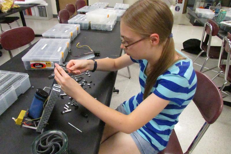 Megan Czechanski taking apart a VEX robot