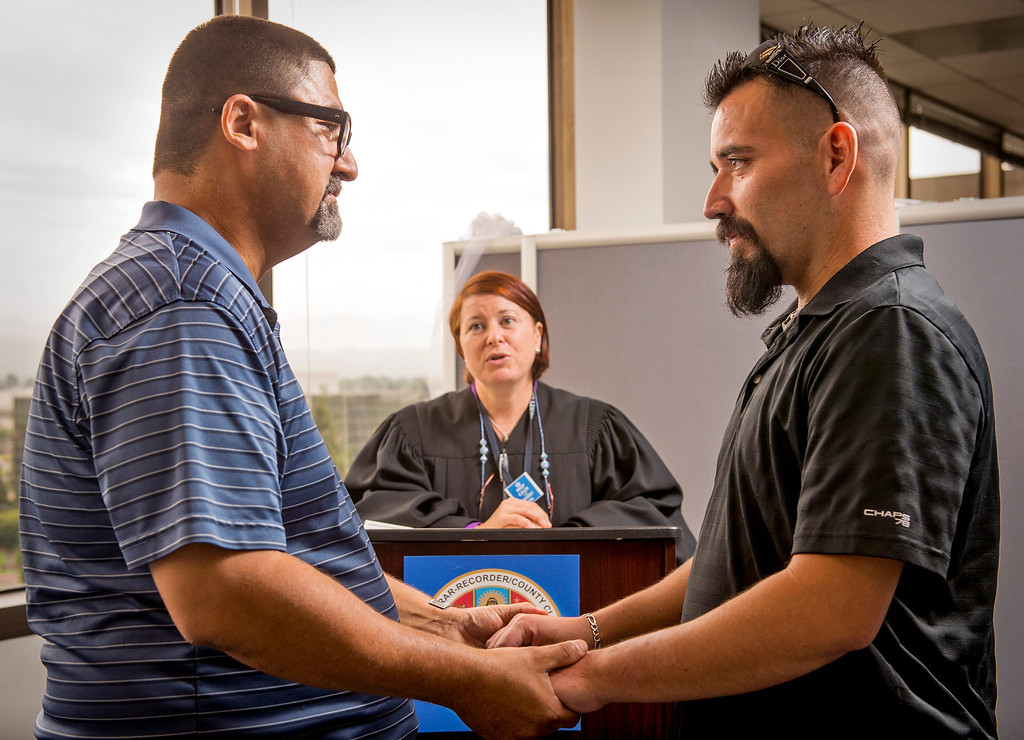 . Joseph Vega, 44, left, and David Martinez, 35, exchange vows during a civil ceremony performed by deputy commissioner Elizabeth Oakes at the Los Angeles County Registrar-Recorder/County Clerk office in Norwalk, Ca. July 1, 2013.   (SGVN staff photo by Leo Jarzomb)