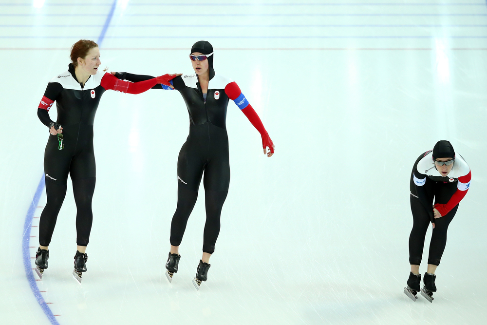 . (L to R) Kali Christ, Brittany Schussler and Ivanie Blondin of Canada react after competing during the Women\'s Team Pursuit Final C Speed Skating event on day fifteen of the Sochi 2014 Winter Olympics at  at Adler Arena Skating Center on February 22, 2014 in Sochi, Russia.  (Photo by Ryan Pierse/Getty Images)