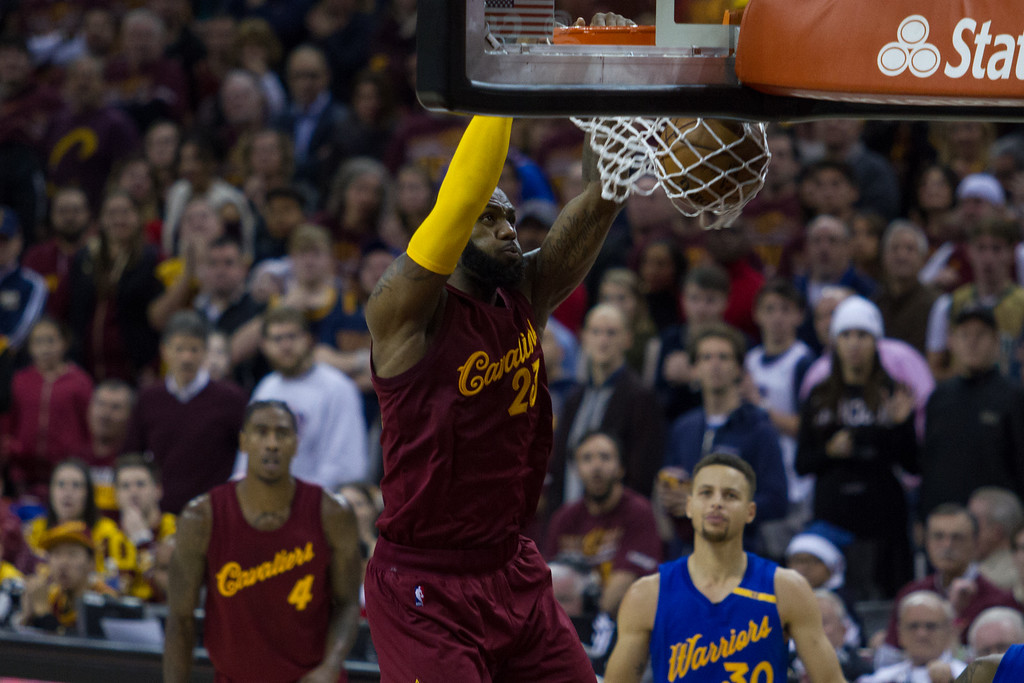 . LeBron James (23) of the Cleveland Cavaliers dunks the ball during an NBA game at the Quicken Loans Arena on Christmas day.  The Cavs defeated the Warriors 109-108.  Michael Johnson - The News Herald