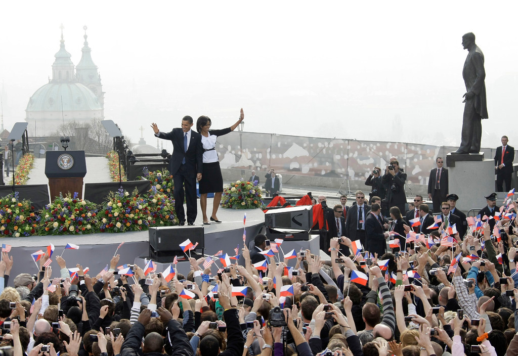 . US President Barack Obama, left, and his wife Michelle greet the crowd prior to his speech in front of the Castle in Prague, Czech Republic, Sunday, April 5, 2009. Obama will also attend a summit between the United States and the 27-member European Union in Prague on Sunday. Seen in background left is the St. Nicholas church, on right is the statue of of Tomas Garrigue Masaryk, the first President of former Czechoslovakia.  (AP Photo/Herbert Knosowski)