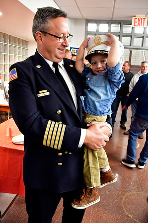 1/14/2020 Mike Orazzi | Staff Holding his grandson Adrian Silva,3, retiring Bristol Fire Chief Jay Kolakoski is honored at Bristol City Hall on his way to his last fire board meeting on Tuesday evening.