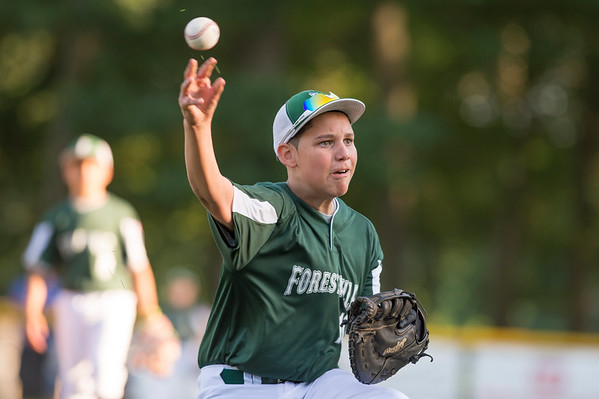 07/08/19 Wesley Bunnell | Staff Forrestville vs Southington North Little League baseball at Recreation Park in Southington on Monday July 8, 2019. Greyson Pierce (10) fields in front to the base and throws to first but the runner was ruled safe.