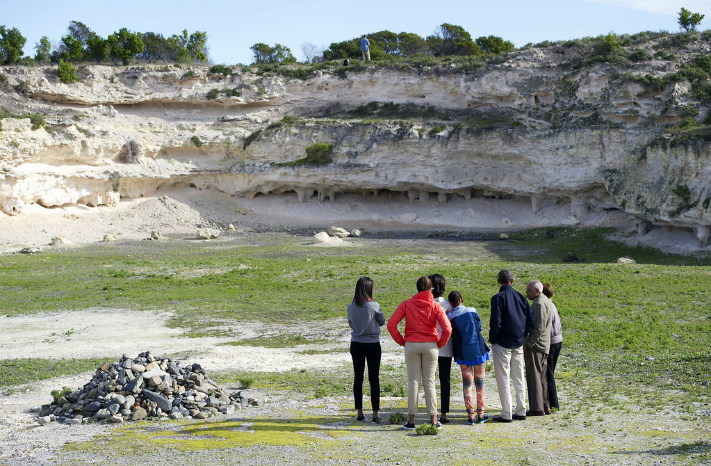 ". US President Barack Obama (3R), First Lady Michelle Obama (C) and their family, tour a limestone quarry where prisoners would work at Robben Island outside Cape Town, South Africa, on June 30, 2013. Obama was ""deeply humbled\"" by a visit to the cell where Nelson Mandela spent years as a prisoner, in a solemn homage Sunday to the critically ill hero he was unable to see in Pretoria.  SAUL LOEB/AFP/Getty Images"