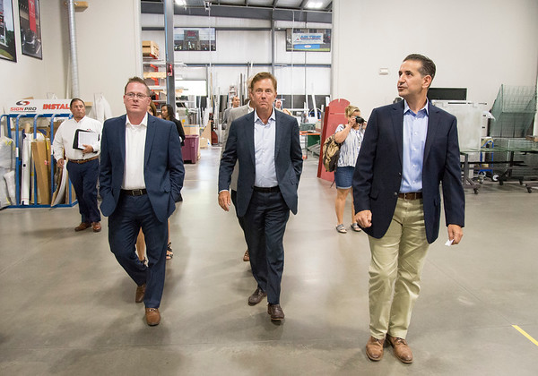 09/09/19 Wesley Bunnell | StaffrrSign Pro's Roger Wierbicki, L, Gov. Lamont and Sign Pro President Peter Rappoccio walk through the facility on Monday afternoon during the governors visit to discuss Proposed Bill No. 5504 An Act Concerning the Net Economic Value of State contracts. The bill recommends the state hire CT businesses on contracts using state funding as part of the state contracting practices.