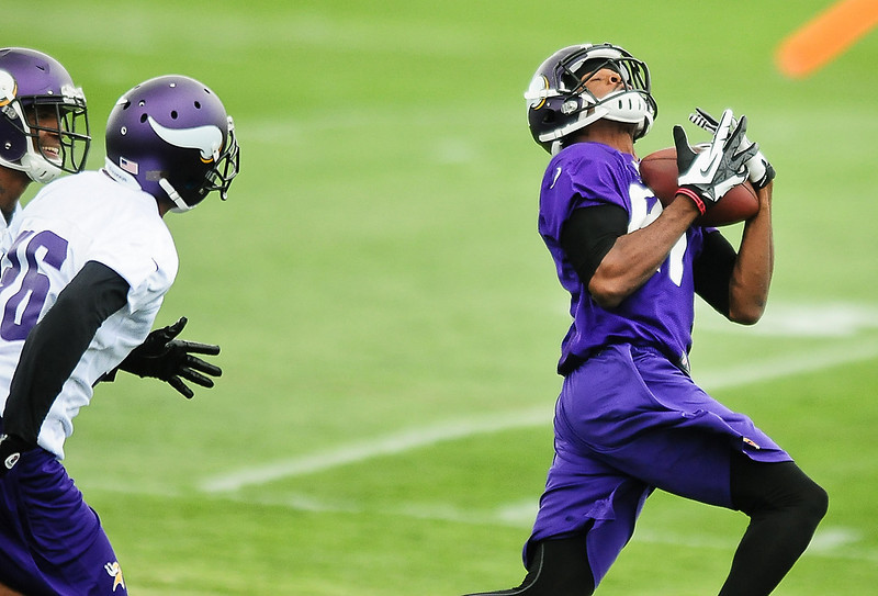 . Minnesota Vikings wide receiver Jerome Simpson catches a long pass at Vikings training camp in Mankato, Minn., on Friday, July 26, 2013. (Pioneer Press: Ben Garvin)