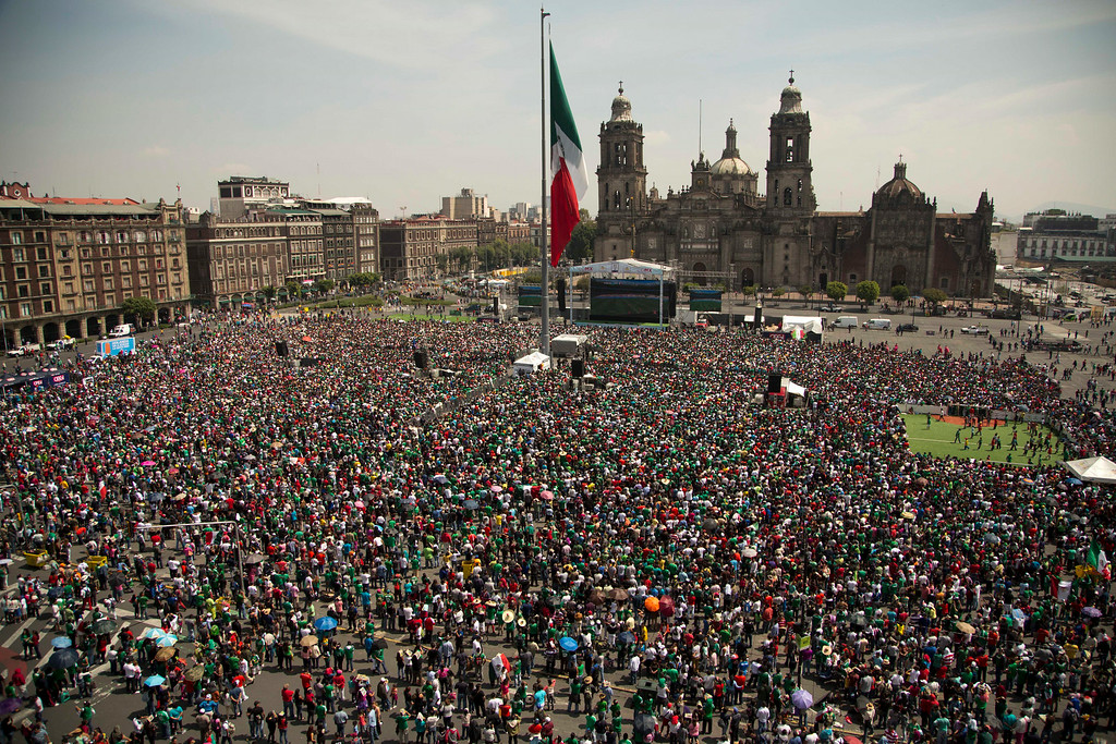 . Mexico soccer fans watch their team\'s World Cup round of 16 soccer match against the Netherlands on giant television screens in Mexico City\'s main square, the Zocalo, Sunday, June 29, 2014. (AP Photo/Moises Castillo)