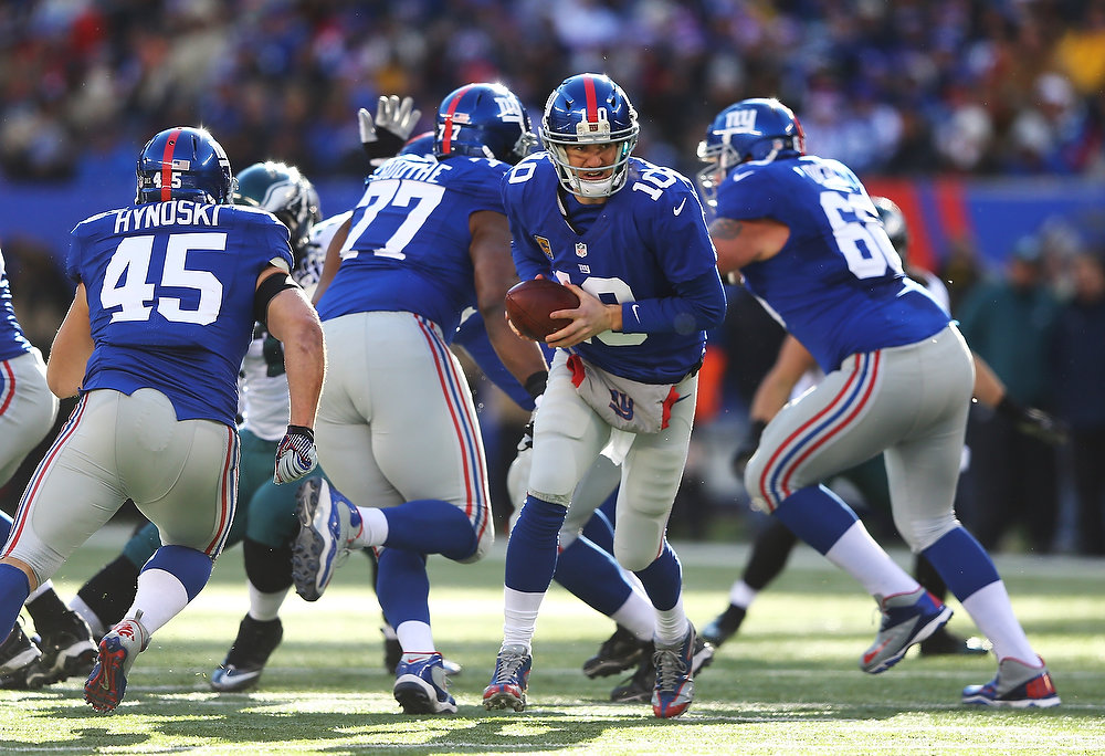 Description of . Eli Manning #10 of the New York Giants in action against the Philadelphia Eagles during their game against the at MetLife Stadium on December 30, 2012 in East Rutherford, New Jersey.  (Photo by Al Bello/Getty Images)