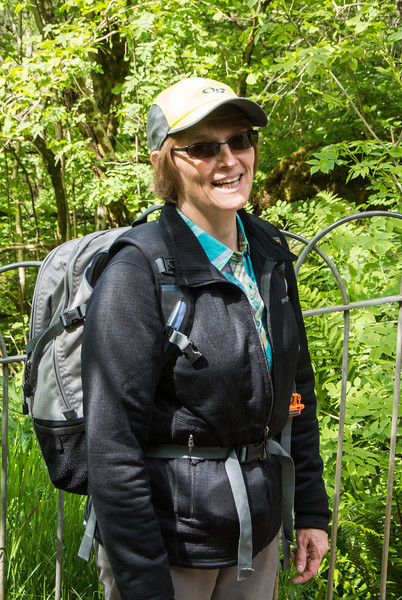 Mom with full hiking gear.
