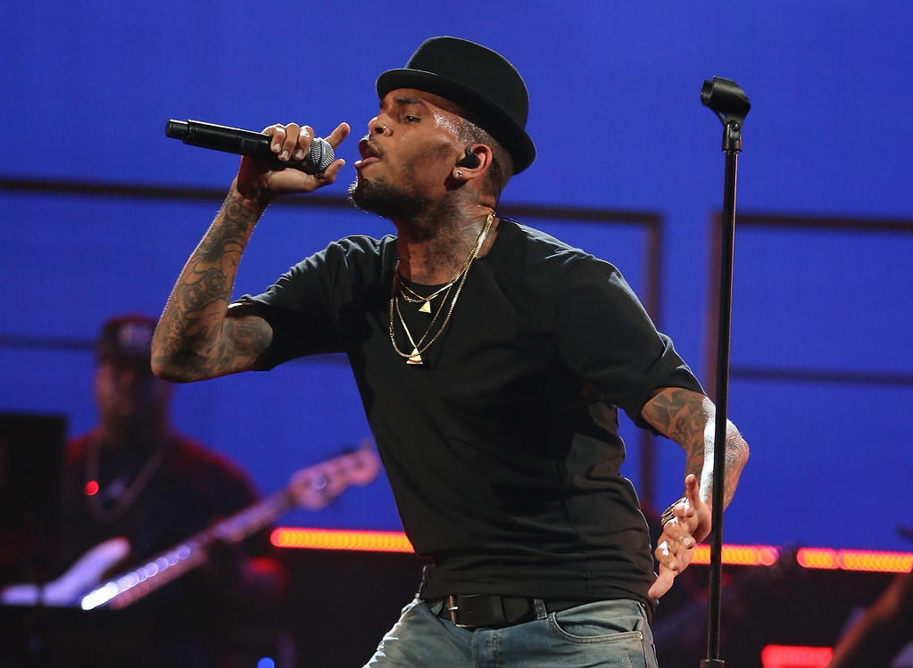 . Singer Chris Brown performs onstage during the iHeartRadio Music Festival at the MGM Grand Garden Arena on September 20, 2013 in Las Vegas, Nevada.  (Photo by Christopher Polk/Getty Images for Clear Channel)