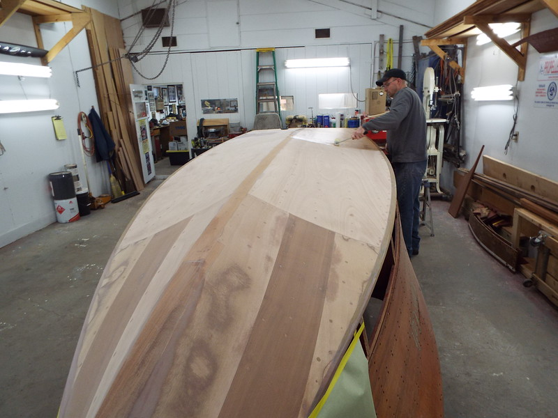 Another view of the first coat of epoxy being applied to the new bottom.