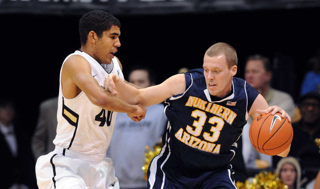 . Max Jacobsen, right, of Northern Arizona tries to muscle past Josh Scott of Colorado during the first half of the December 21, 2012 game in Boulder.   Cliff Grassmick / December 21, 2012
