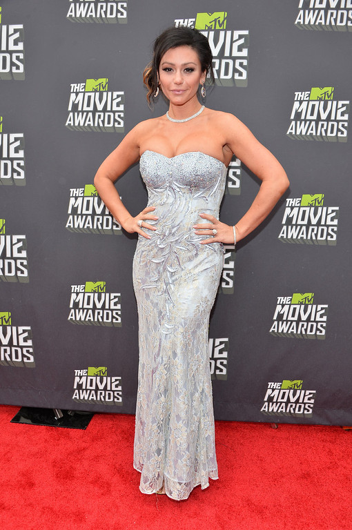 """. TV personality Jennifer \""""JWoww\"""" Farley arrives at the 2013 MTV Movie Awards at Sony Pictures Studios on April 14, 2013 in Culver City, California.  (Photo by Alberto E. Rodriguez/Getty Images)"""