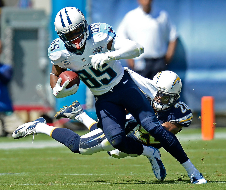 . Tennessee Titans wide receiver Nate Washington (85) gets away from San Diego Chargers defensive back Johnny Patrick (26) in the second quarter of an NFL football game on Sunday, Sept. 22, 2013, in Nashville, Tenn. (AP Photo/Mark Zaleski)
