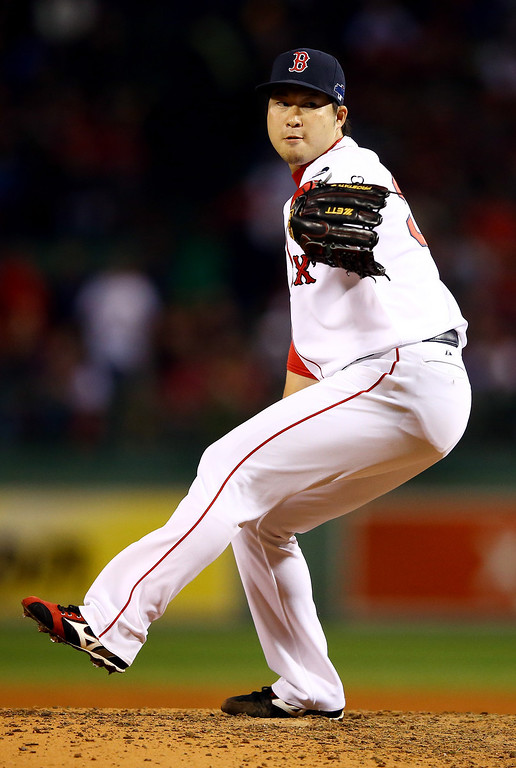 . BOSTON, MA - OCTOBER 12:  Junichi Tazawa #36 of the Boston Red Sox pitches against the Detroit Tigers in the seventh inning of Game One of the American League Championship Series at Fenway Park on October 12, 2013 in Boston, Massachusetts.  (Photo by Al Bello/Getty Images)