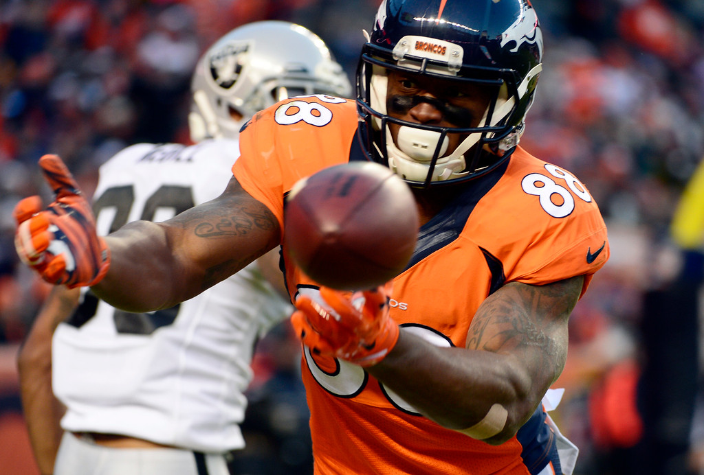. DENVER, CO - DECEMBER 28: Demaryius Thomas (88) of the Denver Broncos drops a pass missing a touchdown in the third quarter.  The Broncos scored a field goal on the next play.  The Denver Broncos played the Oakland Raiders at Sports Authority Field at Mile High in Denver on December, 28 2014. (Photo by Tim Rasmussen/The Denver Post)