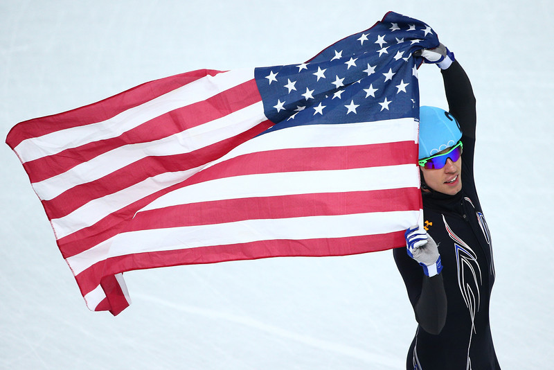 . Jordan Malone of the United States celebrates winning the silver medal in the Short Track Men\'s 5000m Relay on day fourteen of the 2014 Sochi Winter Olympics at Iceberg Skating Palace on February 21, 2014 in Sochi, Russia.  (Photo by Clive Mason/Getty Images)