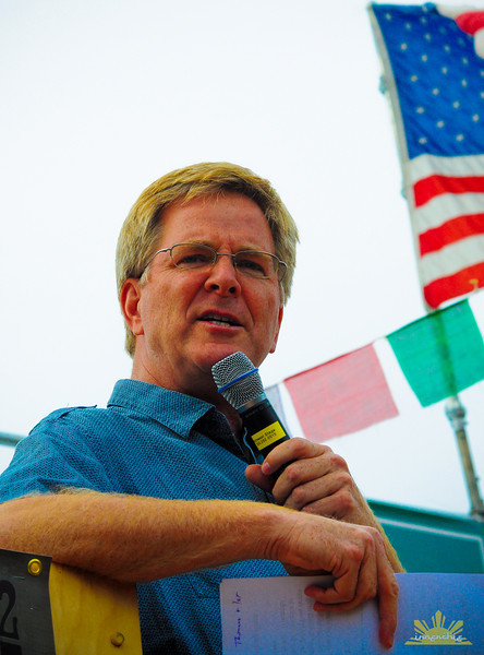 Rick Steves speaks on Main Stage at Hempfest 2012.   Photo by INNERCHIE
