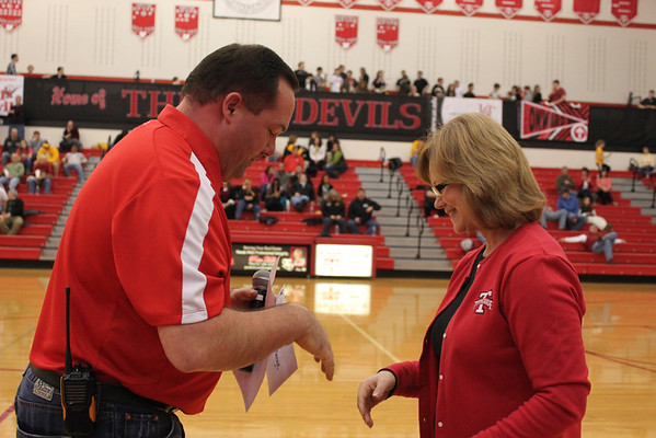Matt Shomper presents check to Athletic Boosters 2012