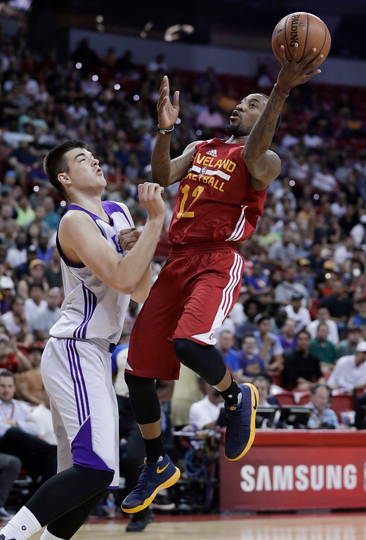 . Cleveland Cavaliers\' Jordan McRae shoots as Los Angeles Lakers\' Ivica Zubac defends during the first half of an NBA summer league basketball game Thursday, July 14, 2016, in Las Vegas. (AP Photo/John Locher)