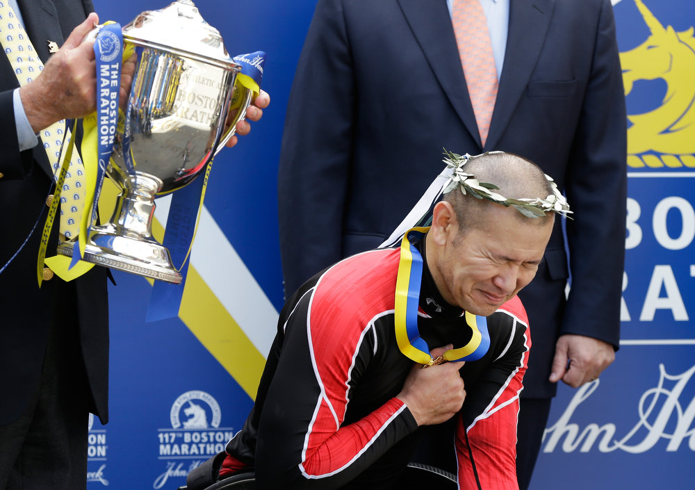 . Hiroyuki Yamamoto of Japan reacts during ceremonies after winning the men\'s wheelchair division of the 2013 Boston Marathon in Boston Monday, April 15, 2013. (AP Photo/Elise Amendola)