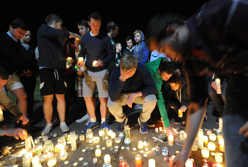 . People react during a memorial Wednesday, June 17, 2015, for those who lost their lives Tuesday after a balcony gave way in Berkeley, Calif.  Dry rot and overcrowding could be responsible for the collapse of the balcony that sent six young Irish nationals plummeting to their deaths.  (Josh Edelson/AFP/Getty Images)