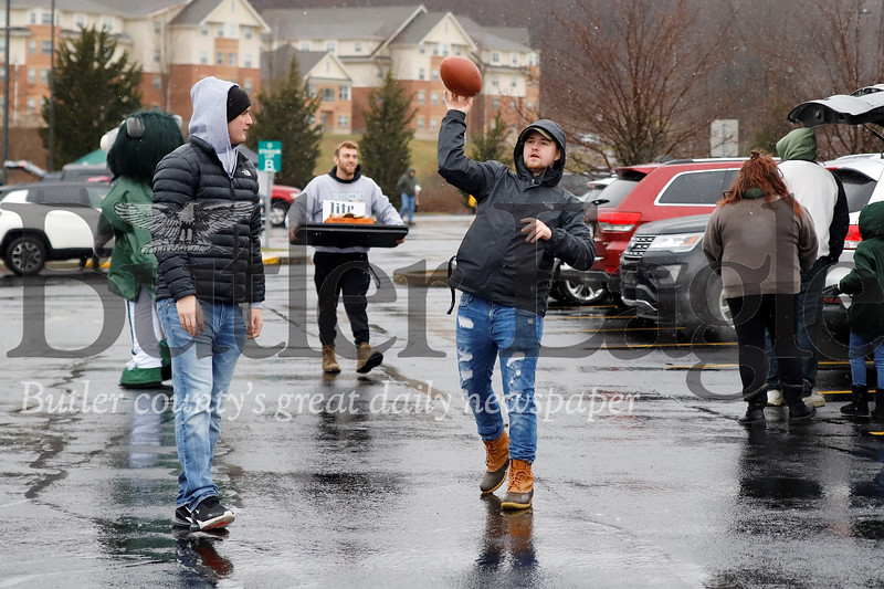 A couple fans through around a football at a pregame tailgate for Slippery Rock's playoff game Saturday against Minnesota State. Seb Foltz/Butler Eagle