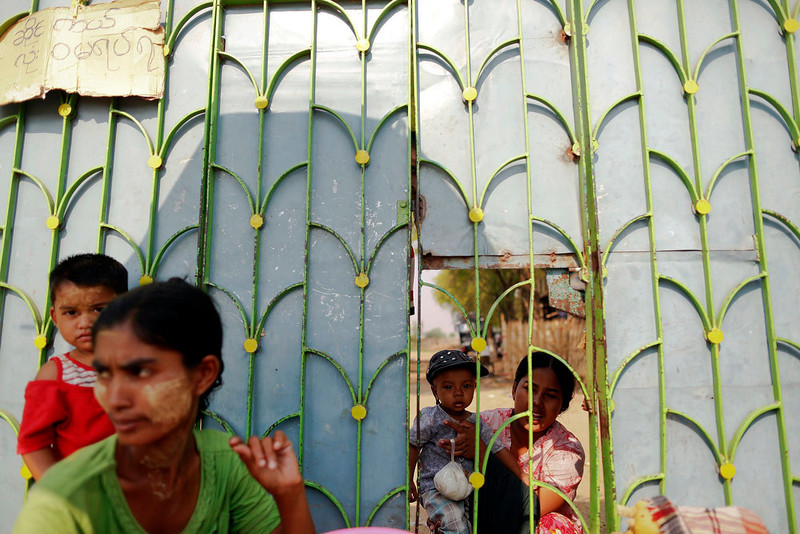 . A woman buys food through the window on a gate of a camp for Muslims displaced by recent violence outside Meikhtila April 24, 2013. In Myanmar\'s central heartlands, justice and security is elusive for thousands of Muslims who lost their homes in a deadly rampage by Buddhist mobs in March. Many are detained in prison-like camps, unable to return to neighborhoods and businesses razed in four days of violence in Meikhtila that killed at least 43 people, most of them Muslims, displaced nearly 13,000, and touched off a wave of anti-Muslim unrest fueled by radical Buddhist monks. Picture taken April 24, 2013. REUTERS/Damir Sagolj
