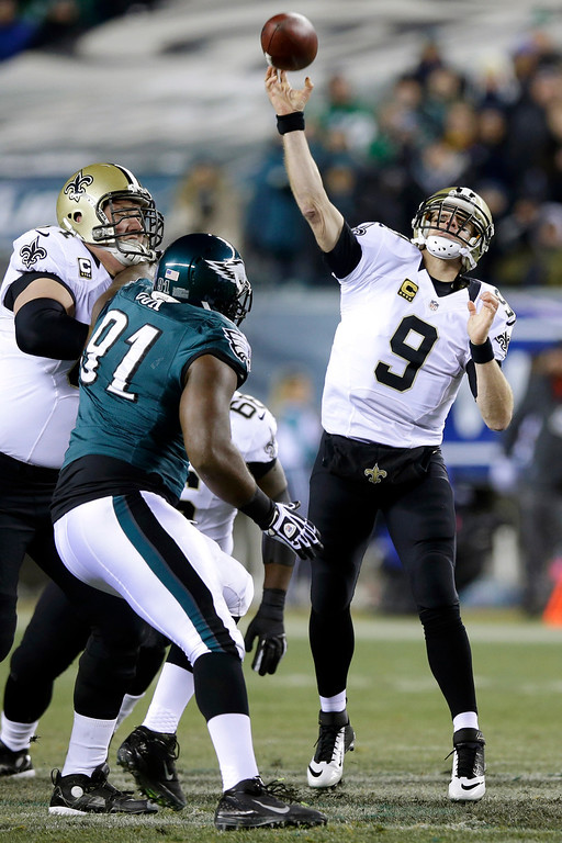 . New Orleans Saints\' Drew Brees (9) passes during the first half of an NFL wild-card playoff football game against the Philadelphia Eagles, Saturday, Jan. 4, 2014, in Philadelphia. (AP Photo/Michael Perez)