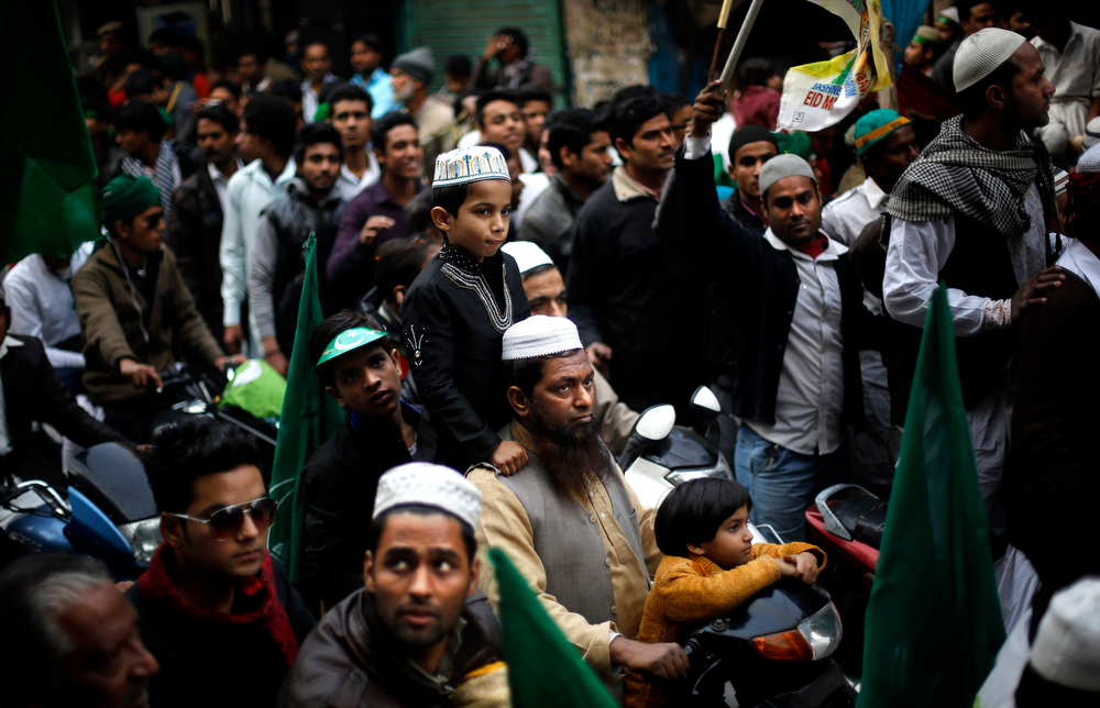 . Indian Muslims participate in a procession on Eid-e-Milad marking the birth anniversary of the Prophet Muhammad, in New Delhi, India, Tuesday, Jan. 14, 2014. Some thousands of people gather along the streets to chant religious slogans during the annual Eid-e-Milad festival marking the anniversary of Prophet Muhammad\'s birth. (AP Photo/Altaf Qadri)
