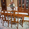 Luxury wooden dining room table and chairs.