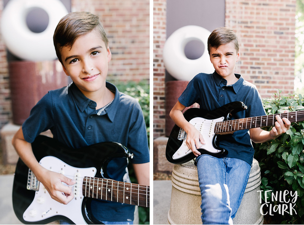 Downtown Pleasanton, CA kids model headshots for JE Model by Tenley Clark Photography. Boy with electric guitar in front of brick wall.