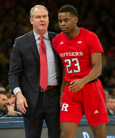 02/01/20 Wesley Bunnell | StaffrrRutgers University men's head basketball coach Steve Pikiell speaks with guard Montez Mathis (23) during a game against the University of Michigan on Saturday Feb. 1, 2020.